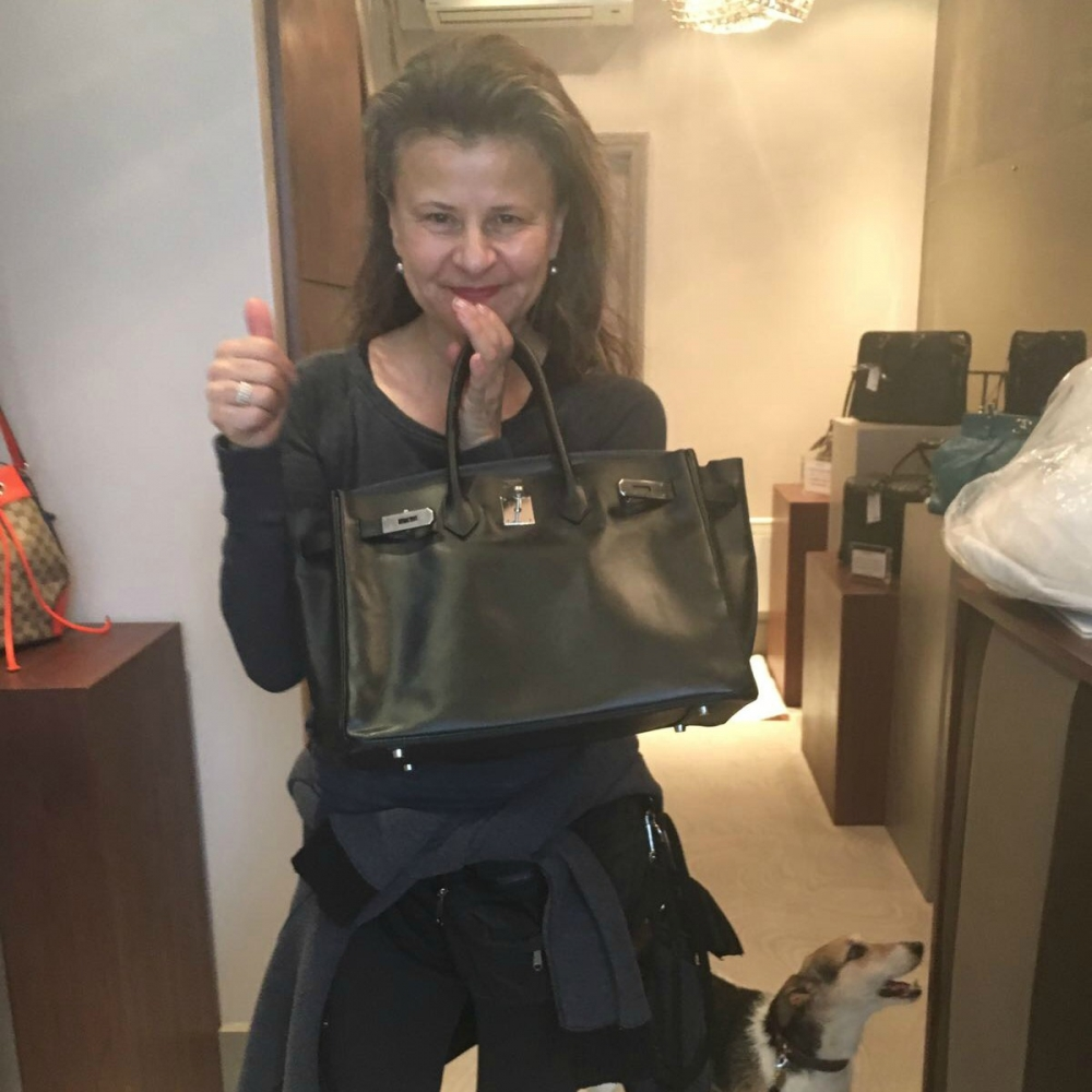 A very happy Tracey Ullman, picking up her restored bag from our Islington store.